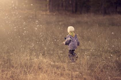 kid, child, girl, back, grass, playing, scarf, beanie, jacket, drops