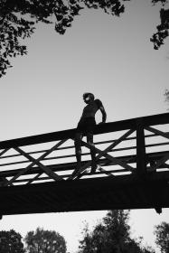 bridge, infrastructure, trees, plants, nature, outdoor, people, man, alone, jump, silhouette, black and white, sky