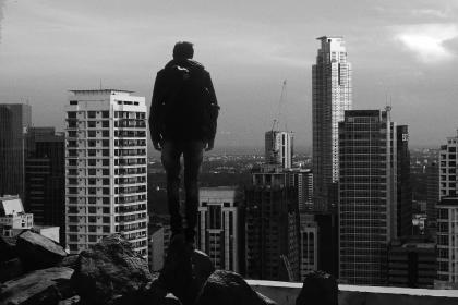 architecture, buildings, infrastructure, city, urban, tower, skyline, skyscraper, construction, rock, ridge, people, man, alone, sky, black and white
