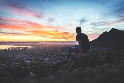 view, valley, cliff, hill, sunset, sky, cloud, people, man, guy, sitting, silhouette