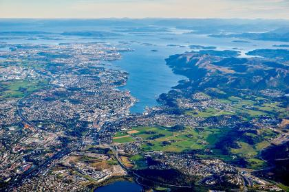 aerial, view, buildings, structure, architecture, skyline, city, urban, plants, trees, street, road, sea, ocean, blue, water, nature, landscape, mountain, highland, outdoor