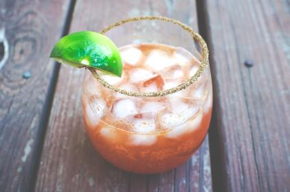 michelada, alcohol, cinco do mayo, glass, drink, lemon wedge, red, wood, ice cubes