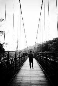 man, walking, bridge, black & white, people, travel, adventure, river, hoodie, jeans, person