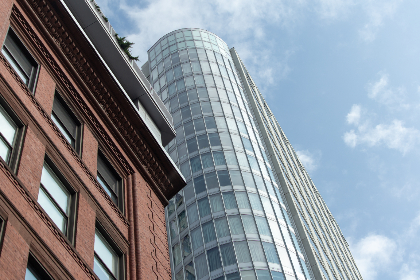 tall,   building,   city,   downtown,   windows,   architecture,   glass,   style,   exterior,   office,   sky,   clouds,   business,  brick,  angle