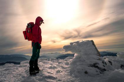 people, man, travel, adventure, alone, snow, winter, cold, weather, ice, mountain, mountaineer, clouds, sky, sun, back pack, jacket, coat
