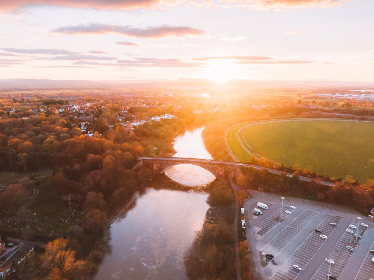 sunset,  river,  aerial,  dusk,  dawn,  bridge,  parking,  warm,  golden,  sky,  clouds,  road,  cars,  travel,  view