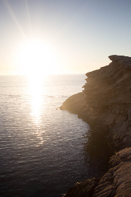 rocky,  shore,  sunset,  water,  ocean,  sea,  sky,  nature,  outdoors,  environment,  climate,  reflection,  sunlight,  bright,  glare,  beautiful,  cliff