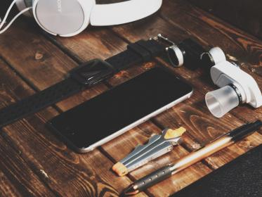 iphone, mobile, smartphone, cell phone, watch, pencil, tools, headphones, objects, audio, technology, table, wood, business