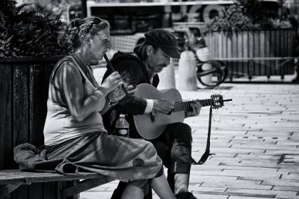 people, man, guy, woman, lady, guitar, flute, bottle, plastic, bench, garden, plants, music, song, singing, couple, lovers, black and white