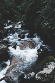 river, stream, water, rocks, green, moss, plants, trees, nature, people, sitting, alone, relax, outdoor