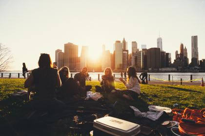 girls, women, people, friends, students, smile, smiling, happy, fun, picnic, grass, outdoors, sunset, skyline, buildings, architecture, city, New York, sky, group