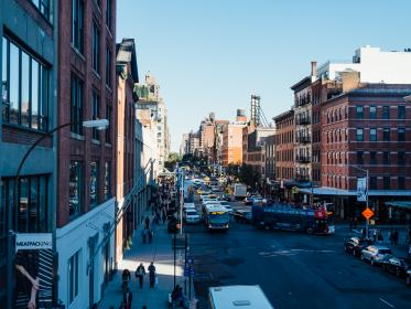 city, streets, roads, bus, cars, traffic, people, walking, pedestrians, sidewalk, buildings, architecture, sunshine, shadows, intersection