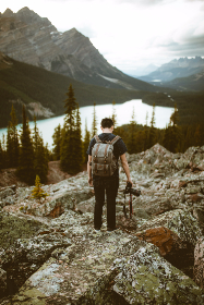 Boy,  guy,  man,  male,  person,  people,  lake,  nature,  earth,  sky,  rocks,  mountain,  mountains,  Pyeto,  Alberta,  photographer,  photograph,  photo,  camera,  Canon,  lens,  backpack,  asian,  Chinese
