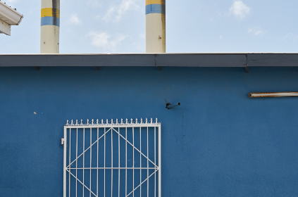 industrial,   building,   manufacturing,   wall,   gate,   outdoors,   exterior,   blue,   sky,   clouds,   abstract,  natural,  pattern,  shape,  roofline,  gutter