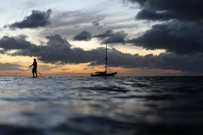 people, man, fishing, boat, sea, ocean, water, wave, beach, dark, sky, clouds, sunset