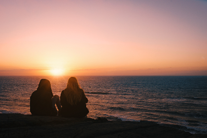 ocean, sunset, friends, water, sea, sunlight, sky, nature, outdoors, horizon, sitting, relax, enjoy, peaceful, waves, people