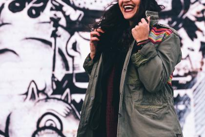 people, girl, woman, female, smile, laugh, happy, clothing, coat, jacket, wall, art