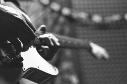 crafts, hobby, music, instrument, guitar, strum, play, guy, man, people, hands, fingers, still, bokeh, black and white
