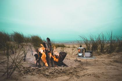 fire, flame, bonfire, campfire, beach, heat, firewood, grass, sand, kitchenware, picnic, sea, ocean, water, coast, shore, travel, vacation, relax, horizon, clouds, sky