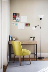 table, chair, desk, lamp, room, carpet, books, pens, posters, picture stickers, photograph