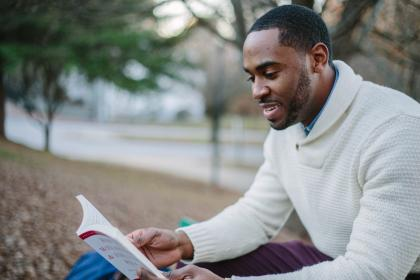 people, man, guy, smile, happy, reading, book, sitting, outside, black, african american