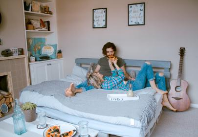 room, bed, indoor, people, couple, man, woman, guitar, food, eating, glass, drink, frame