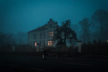 architecture, building, infrastructure, dark, sky, tree, plant, gate, fence, people, alone, walking, outside, street, house, creepy, fear