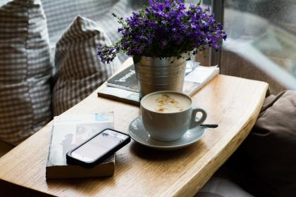 paper, note, book, table, vase, flower, lavender, plants, decor, cellphone, iphone, apple, gadgets, technology, pillows, window, glass, wooden, wood, coffee, plate, spoon