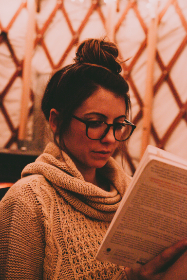 woman,  glasses,  reading,  book,  jumper,  close up,  intelligent,  thoughtful,  paper,  people,  female,  student,  teacher