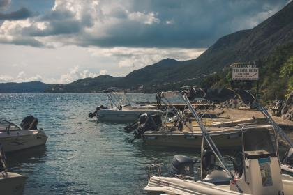 sea, ocean, water, clouds, sky, sunny, boat, machine, highland, mountain, green, plants, trees, nature, landscape, adventure, outdoor, travel, vacation