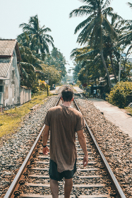 man,  walking,  tracks,  train,  transport,  alone,  summer,  vacation,  holiday,  travel,  palm tree,  house,  building