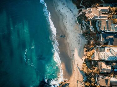 sea, ocean, blue, water, waves, nature, rocks, coast, shore, buildings, hotel, resorts, summer, vacation, aerial, view, travel, outdoor