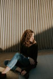 people, woman, fashion, beauty, brunette, casual, ripped jeans, sweater, sunny, shadow