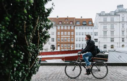 architecture, building, infrastructure, green, plant, tree, boat, people, man, guy, riding, bike, travel, bicycle