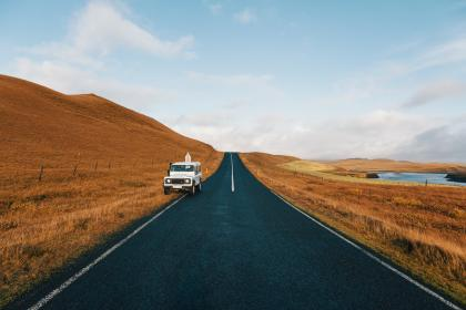 road, highway, car, vehicle, travel, trip, highland, grass, grassland, blue, sky, cloud