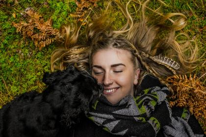 green, grass, lawn, black, puppy, dog, pet, people, woman, girl, smile, happy, outdoor, nature