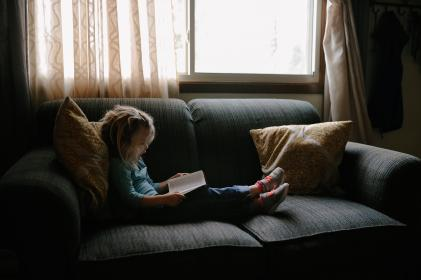 kid, people, girl, child, sitting, couch, pillow, reading, book, bible, window, glass, curtain, inside, house