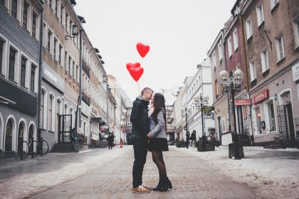 people, man, woman, couple, love, affection, intimacy, heart, valentines, road, street, urban, city, architecture, building, establishment, balloons, shop, store