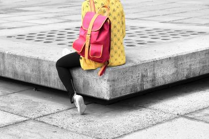fashion, travel, woman, girl, female, lady, yellow, pink, backpack, bag, sweater, jeans, concrete, city, urban, lifestyle, student