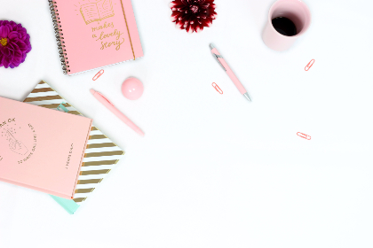 workplace,  desk,  feminine,  notes,  notebooks,  diary,  pens,  pink cup,  pink diary,  gold diary,  striped diary,  dahlia,  flowers,  paper clip,  pink paper clip,  girly,  purple,  pink,  gold,  golden,  white background,  flat lay,  cup of coffee,  turquoise,  red dahlia,  pocketbook,  write