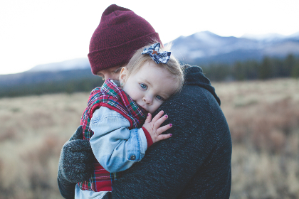 family,  child,  cuddle,  hug,  hike,  trail,  walk,  woman,  baby,  people,  tired,  hat,  field,  grass,  cold,  frost,  mountain,  snow,  cloudy