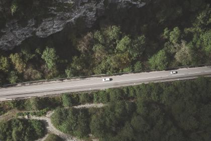 aerial, view, mountain, hill, trees, plants, green, forest, pathway, road, trip, travel, car, vehicle