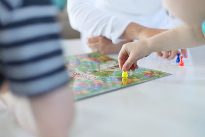 playing,  game,  kids,  table,  hands,  board,  entertainment,  puzzle,  pieces,  child,  children,  close up,  family,  play,  sitting,  home,  people,  interior