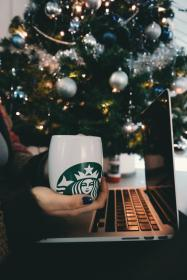 laptop, apple, macbook, computer, browser, research, study, school, business, work, desk, hand, people, hand, cup, coffee, starbucks, christmas, tree, lights, ball, ornament, decor, holiday, season