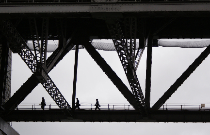 people,  crossing,  bridge,  monochromatic,  silhouette,  city,  modern,  skyline,  pedestrians,  citizens,  cityscape,  figures,  engineering,  architecture,  walking, urban
