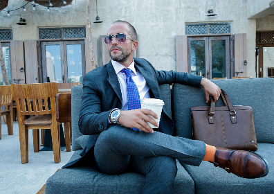 man,  sunglasses,  waiting,  fashion,  model,  suitcase,  business,  shoes,  socks,  orange,  watch,  style,  bar,  restaurant,  drink,  coffee