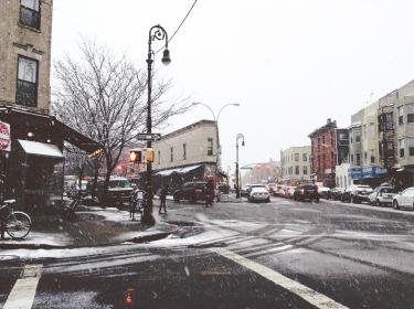 city, streets, NYC, New York, crosswalk, intersection, cars, snow, flurries, buildings