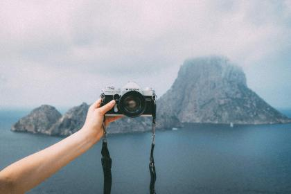 camera, lens, selfie, slr, hand, arm, island, mountain, sky, clouds, fog, water, ocean, sea