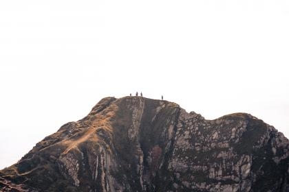 people, man, woman, lady, guy, mountain, nature, climber, hiking, travel adventure, trip, view, sky, clouds, rock, formation, mountaineer, grass