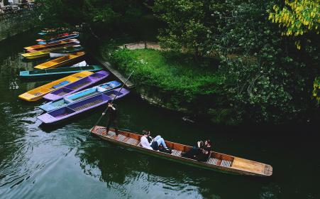 people, men, guys, girl, boat, sailing, pole, paddle, lake, water, green, grass, nature, trees, adventure, outdoor